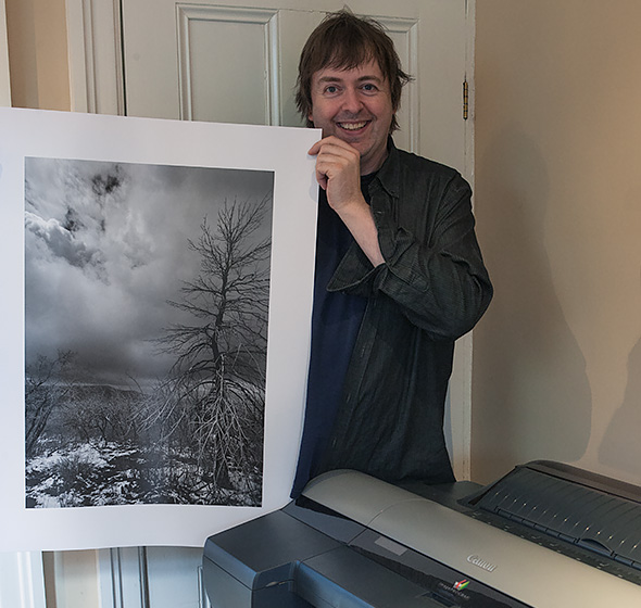 Keith Cooper with black and white print