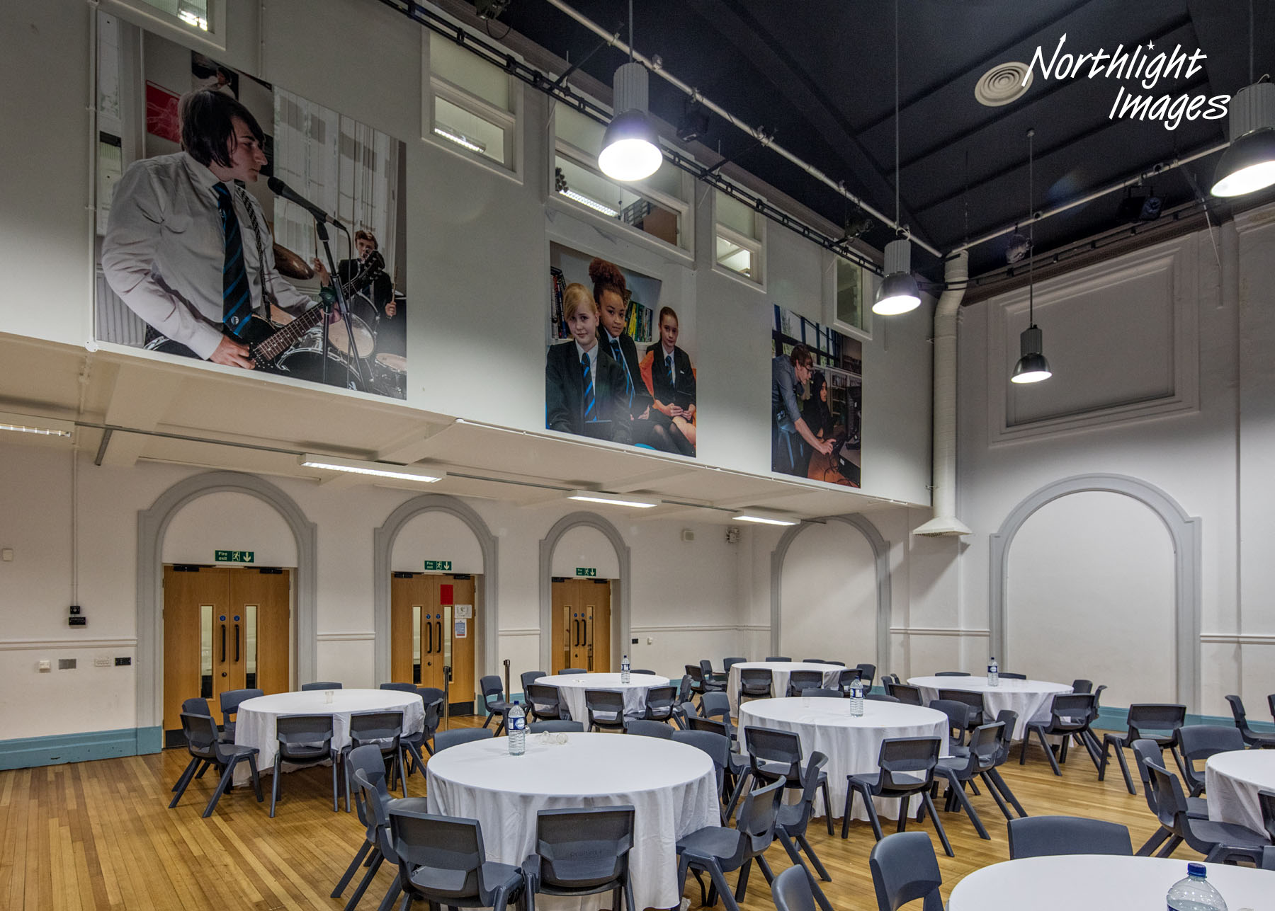large wall mounted prints in hall